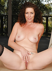Brunette and lacey Tammy Sue pulls down her pink thong in here