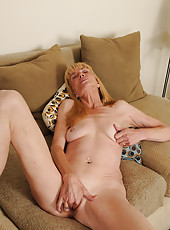57 year old Pam from AllOver30 strips and inserts her fingers deep