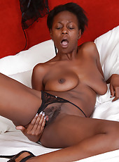 30 year old chocolate MILF Entice pushes her long fingers deep inside
