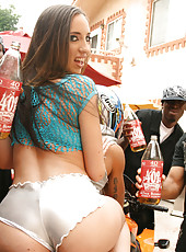 Stacked brunette Kelly gets a 40 poured on her ass