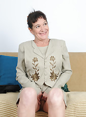 50 year old Anna D from AllOver30 slips off her suit and shows her tits