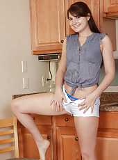 Tight bodied 30 year old Paige spreading her legs wide in the kitchen