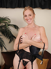 50 year old Jenna Covelli strips and tugs on her huge mature nipples