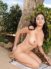 Hot brunette Bianca Mendoza posing naked by a tree out in the yard