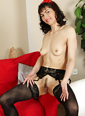 39 year old brunette Mona B wearing sexy black stockings and lingerie
