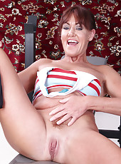 Redheaded Shauna from AllOver30 works out her arms and her pussy