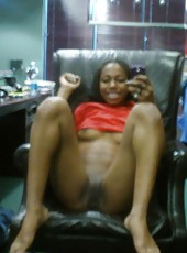 Naughty black slut stripping naked and spreading on a chair