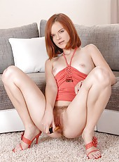 Sexy redhead Denisa sports her bush