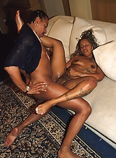 Inked up ebony slut sucking a big black schlong