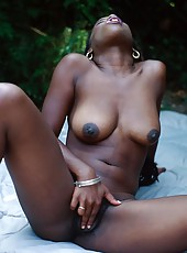 Horny black slut masturbates as she sucks cock