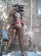 Picture compilation of an amateur ebony teen posing outdoors