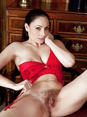 Sophia Delane looks smoking hot in her business uniform. She takes off her shirt giving a better look at her red lingerie. Lifting up her skirt she shows her hairy pussy spreading her lips wide.