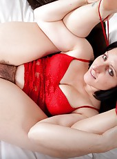 Amber Lustful is an attractive hairy girl laying in bed wearing seductive red lingerie. As she slowly removes it she shows off her hairy pussy by using her fingers to spread her hairy pussy apart.