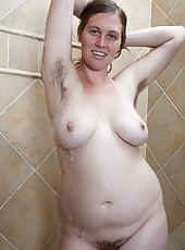 Lindsay is taking a shower. She gets her hands nice and soapy, rubbing them all over her large breasts and making sure to clean her hairy pits and pussy before spraying herself to completion.
