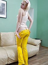 Pretty little Elen is bored in her bright yellow jeans. She moves around restlessly before barely rubbing her hand along her hairy pussy through her jeans, just enough to get her a little horny.