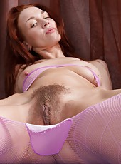Arina loves to party. She loves to wear barely there outfits to let everyone see how dedicated to a hairy lifestyle she is, from her pits to her hairy pussy, this colorful girl is hairy all over!