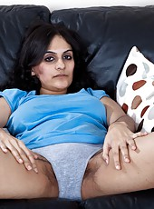 Pretty hairy girl Riani is lounging around her house one day. She is feeling a little blue and doesn