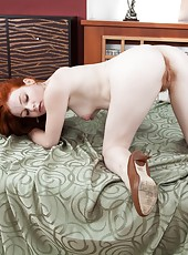 Florence is a fiery redhead babe laying on her bed thinking about fucking! She gets so horny that she lifts up her dress and takes off her bra and panties, then fingers her hairy red pussy!