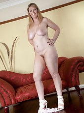 Sophie UK is a natural looking woman with great tits and a hairy pussy that likes to be played with.  She is all by herself, so she sits on the couch masturbating while dreaming of her boyfriend.