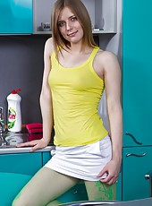 Bright yellow tank, bright green tights, and a bright white skirt? Hairy girl Lavin is glowing at this hairy photo shoot! Watch her strip it all away and show off her equally bright hairy pussy!