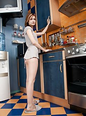 Klea gets kinky in the kitchen and pulls down her pretty pink panties, before mounting the bench and spreading her moist hairy pussy lips with her fingers.