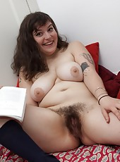 Books down its time for Esther to unveil her sexy curvy body and big fluffy pussy before she lays down and touches her moist pink lips