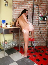 Kinky Mila Z pats flour onto her nice round ass and through her dark haired pussy. Once she gets wet, she tickles her meaty clit.