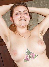 Full of excitement, Jess undresses for the camera and shows off her gorgeous curvy body and big meaty pink bush.
