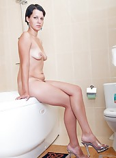 Diana wants you to follow her into the bathroom where she can run warm water through her pussy hair and towel herself off. Will you join her?