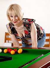 Playing with all those big hard balls has turned Hazel on. Watch her stroke the shaft of the queue and then mount the pool table naked to show off her hairy bush.