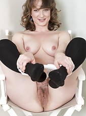 Watch in amazement as fleshy milf Misty sits back in her high chair and spreads her wet pink hairy pussy while smiling cheekily.