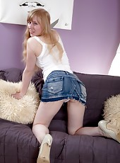 Pale cutie Satine Spark strips on her comfy couch and runs her hands through her soft pussy hair. Come closer as she spreads her legs and pussy lips wide.