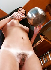 Curvy raven haired beauty Isabella starts of cooking but gets side tracked into filling up her dripping wet pink bush. Dinners ready!