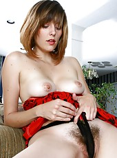 Sasha is at her natural best in her sexy red lingerie and cute little knickers. What a thick bush she has...