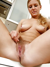 Cute, blonde, sexy and ready to slide a light bulb into her moist, hairy pussy, Alisha loves getting horny in the kitchen.