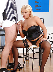 Blonde babe in bustier blows a cock
