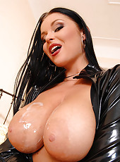 See a babe in sexy latex suck cock