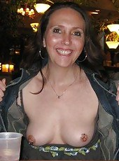 Flashes her pierced nips and shows off her shaved cunt