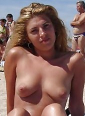 Gallery of a topless blonde housewife at the beach