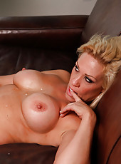 Gorgeous busty blonde mom is horny and catches two boys doing something they should not, so she decides to fuck the one that did not get away.
