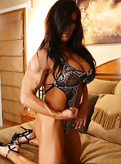 Bodybuilder Angela Salvagno poses her big muscles and strips her clothes off.