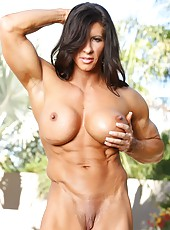 Bodybuilder Angela Salvagno strips from her sling and flexes her big strong body, paying special attention to her big clit and big pussy lips.