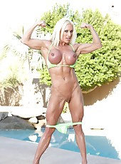 Bodybuilder Ashlee Chambers strips from her bikini and flexes her rock hard body.