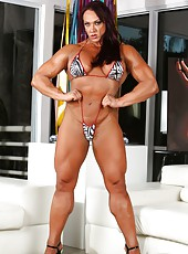 Bodybuilder Amber Deluca strips off her bikini and flexes her huge muscles.