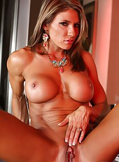 Fitness queen Abby Marie shows off her hot hard body and big clit.