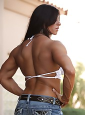 Angelina Salvagno strips off her clothes and flexes her big muscles and huge clit.