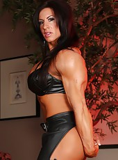 Bodybuilder Angela Salvagno shows off her sexy leather outfit and strong hot muscles.