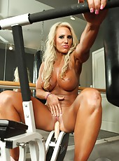 Sexy blonde fitness model Megan Avalon plays with her dildo in the gym.