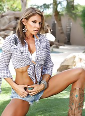 Abby Marie looks like a muscle queen in her daisy duke outfit. She really shows off her hard abs and toned legs as she poses outside.