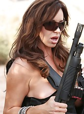 Girls and guns, Rachel Aziani poses with her guns out in the Arizona desert.